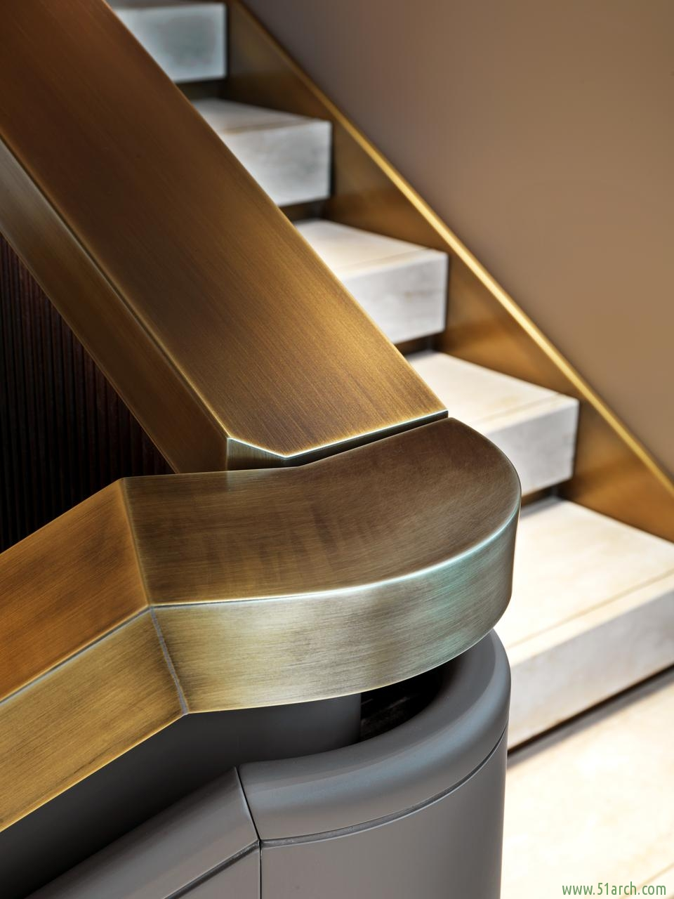 Brioni Boutiques brushed bronze stairwell