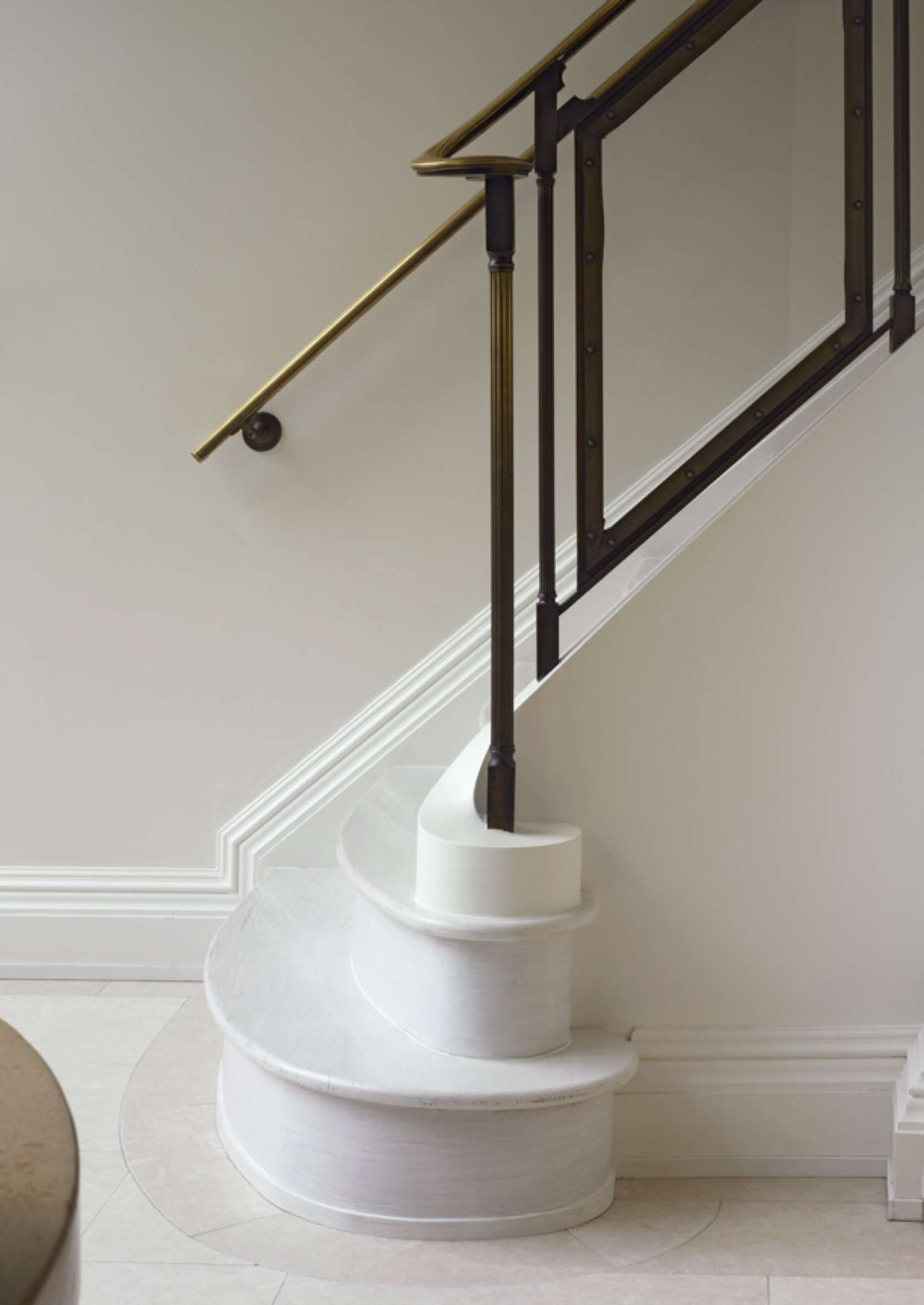 White marble rounded staircase