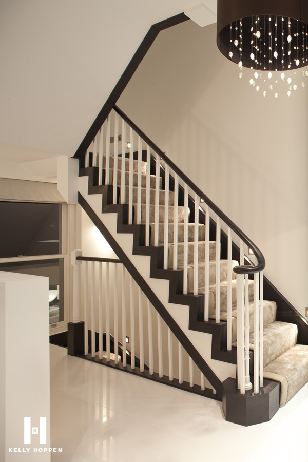 Luxury white and brown staircase with plush beige carpet