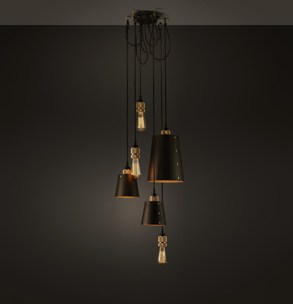 Hanging black and gold chandelier by buster + punch