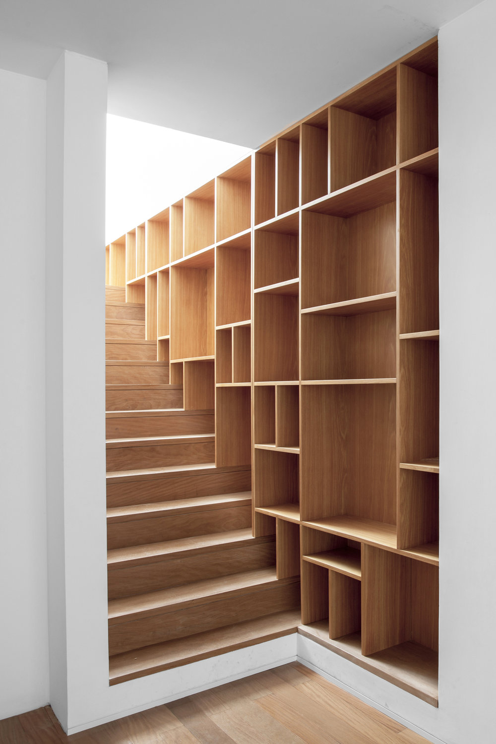 Integrated wooden bookcase and staircase design