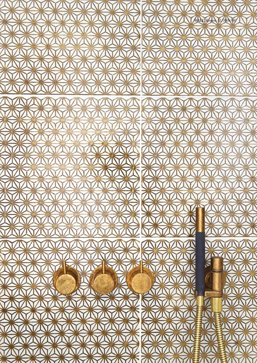 Gold bathroom tiles and brass taps