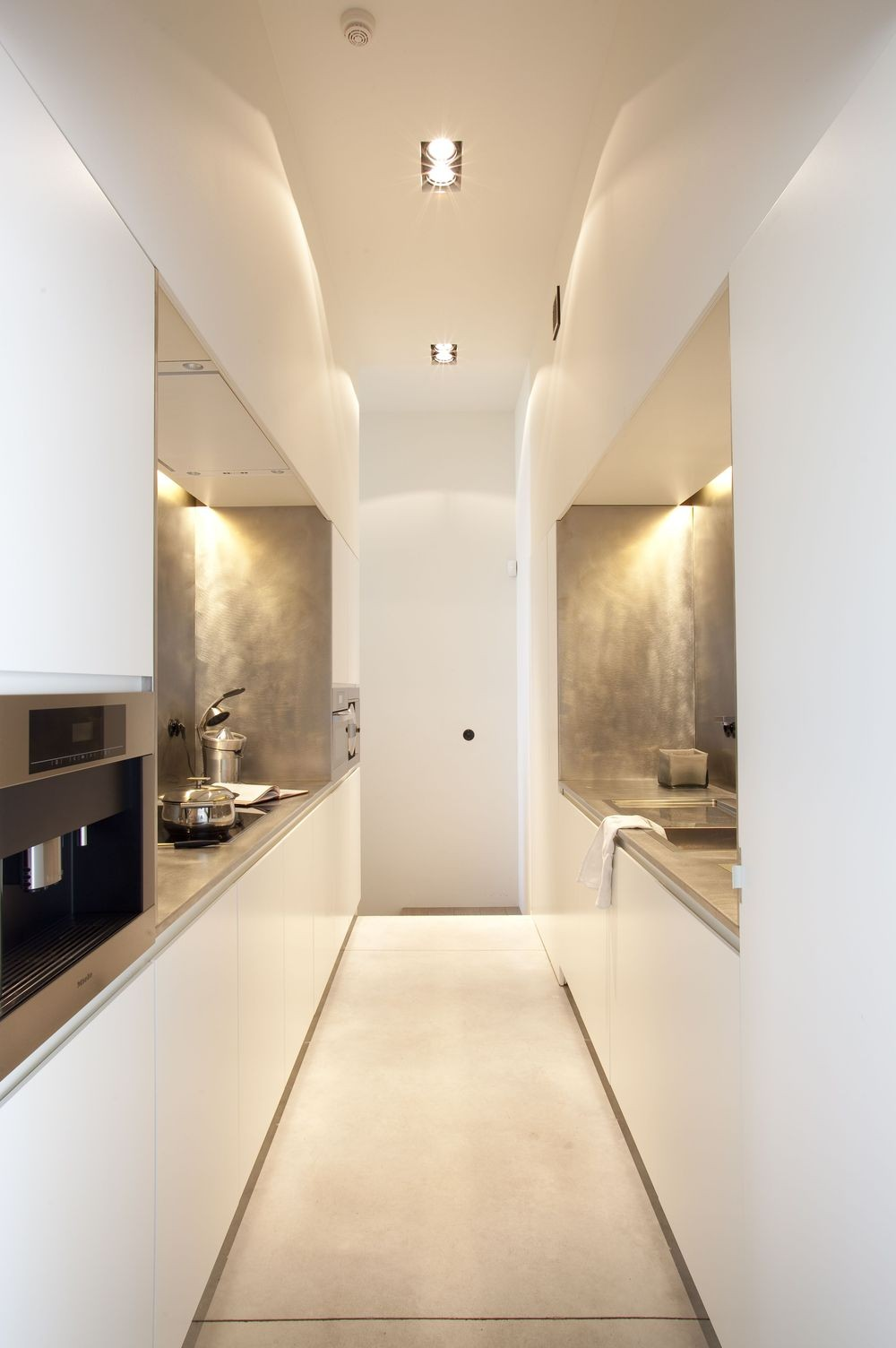 White and grey gallery kitchen