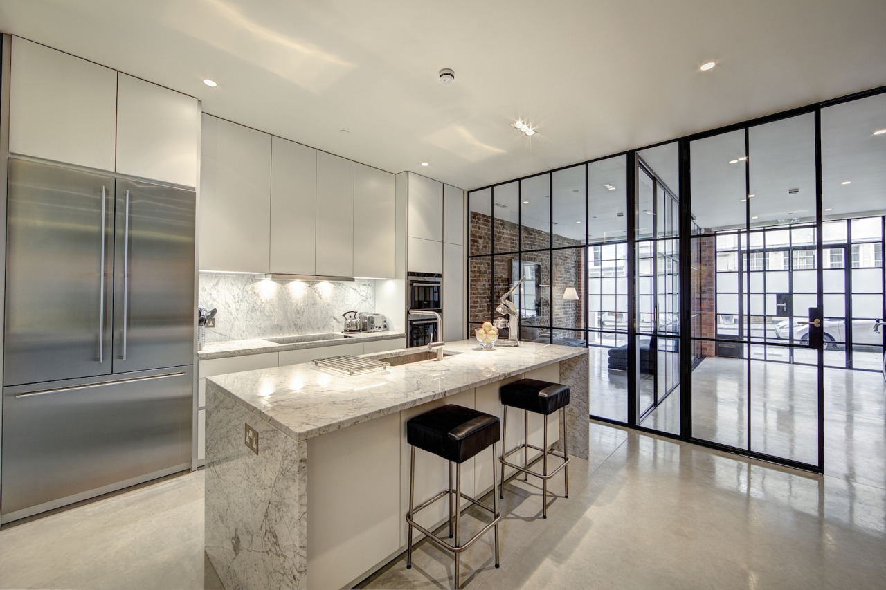 Large white and grey marble island in kitchen