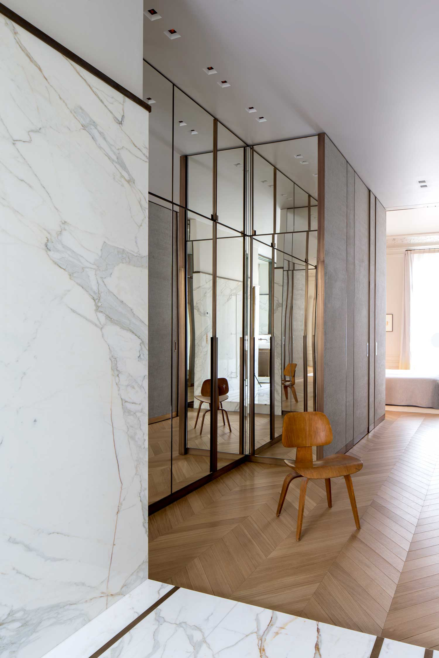 Large marble living room with parquet flooring