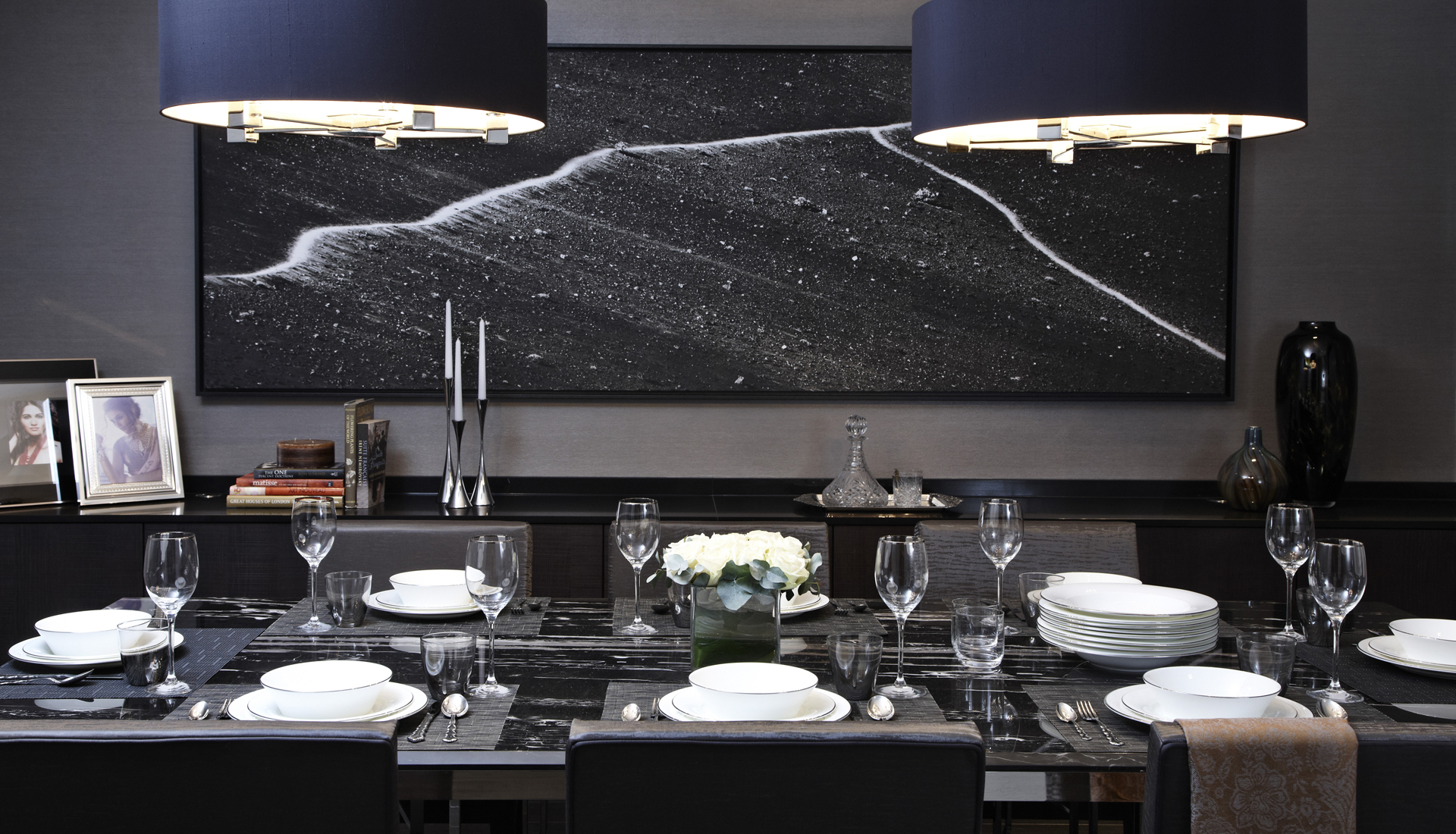 Luxury black and grey dining room with black art