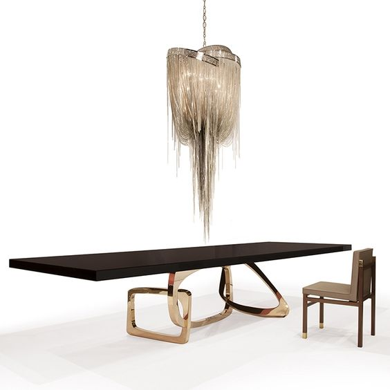 Large wooden table with gold stand by Hudson