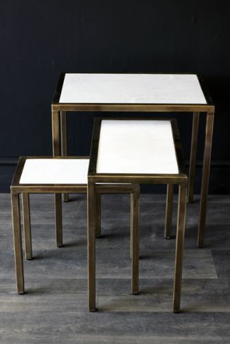 White and bronze nesting tables