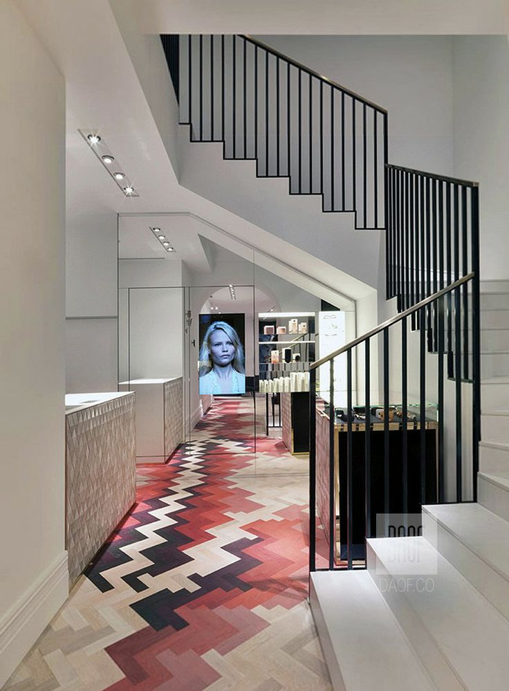 Red parquet floor in entrance