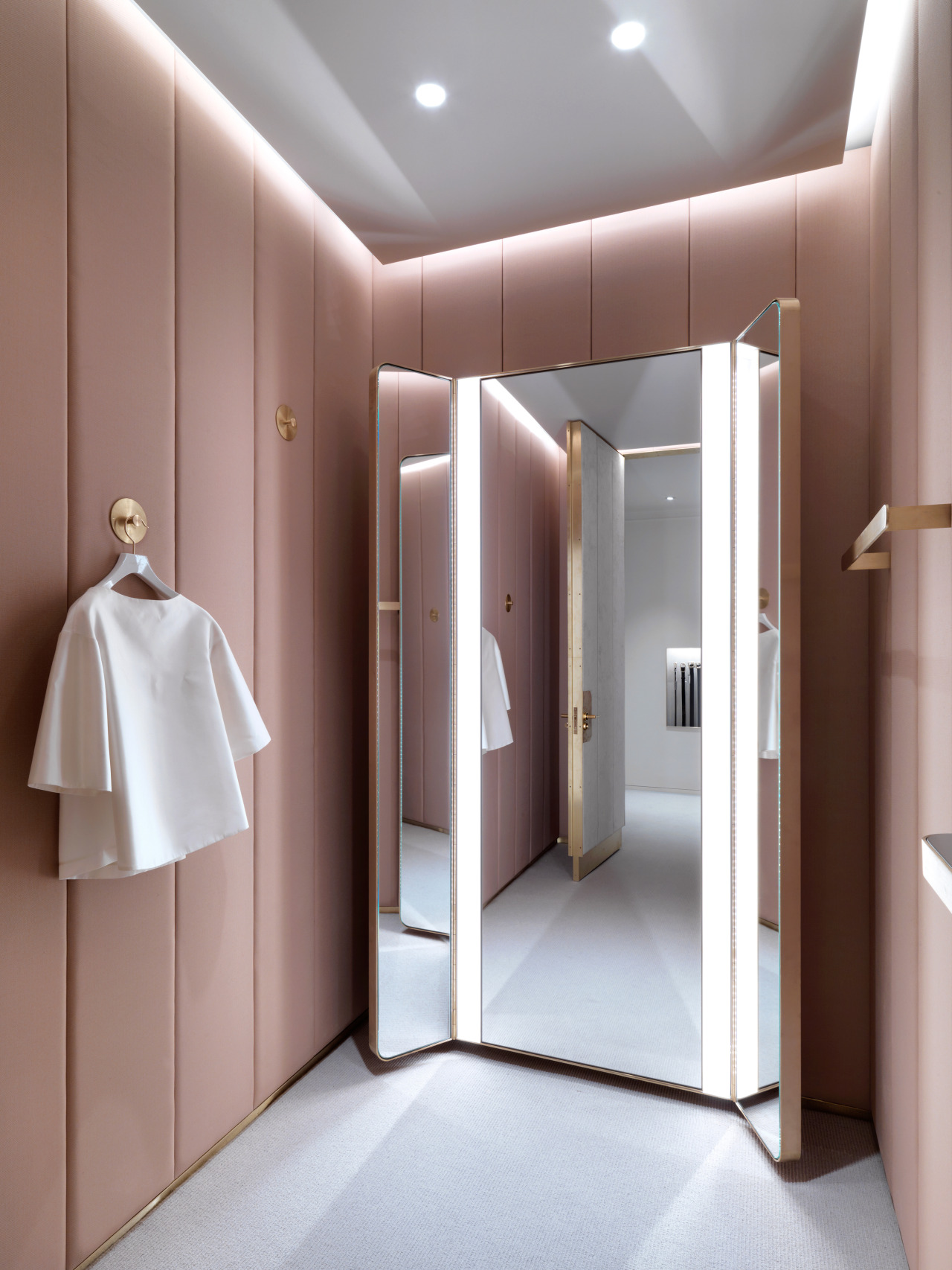 Pastel pink walk in wardrobe space
